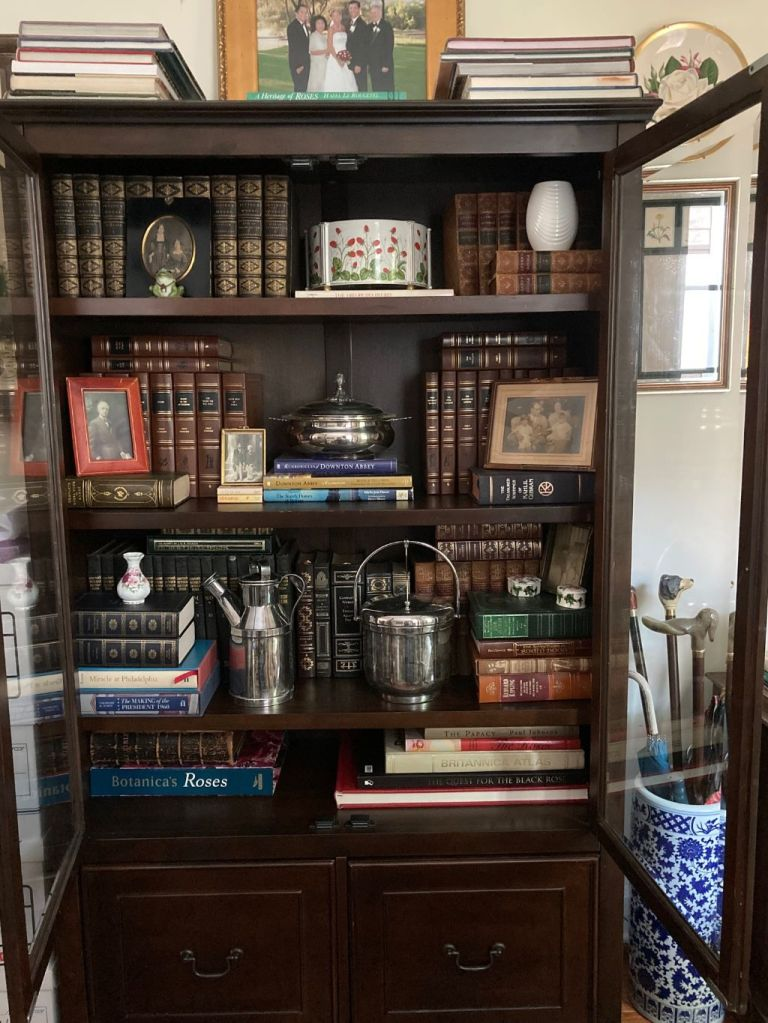 This image has an empty alt attribute; its file name is glass-encased-bookcase-1.jpg